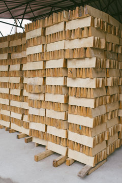 Wood stacked in warehouse