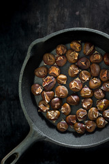 Roasted chestnuts in a cast iron pan
