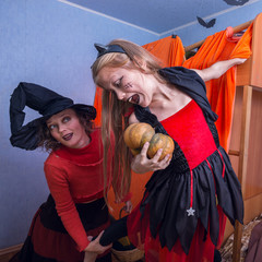 Happy family - mom and daughter in a costumes for Halloween
