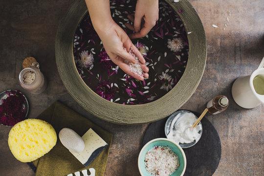 Hands of Woman Preparing a Flower Bath