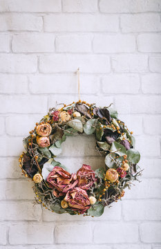 Dry Flowers Ring Hanged on a White Wall