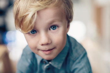 Curious young boy with big blue eyes