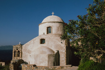 Greek old church with cross.
