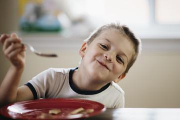 Awesome kid eating pancakes