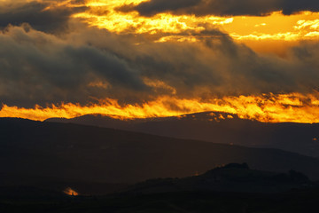 Panoramic view of a rolling landscape at sunset