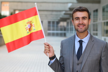 Proud man waving the Spanish flag