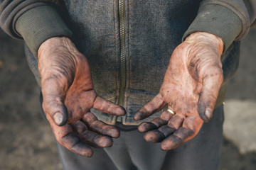 Worker showing his dirty hands