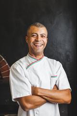 Mixed Race Happy Chef in Italian Pizzeria