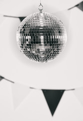 NYE: Mirrored Ball Hangs In Front Of Party Banners