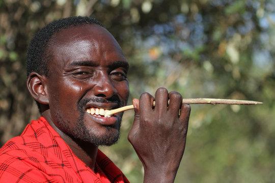Maasai brushing his teeth