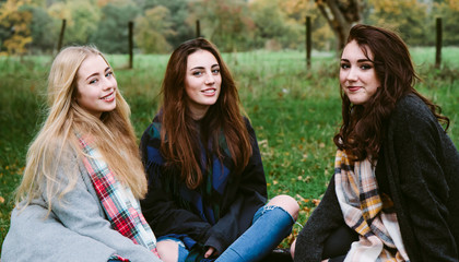 Teenage girls hanging out in the countryside.