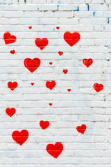 Small red hearts shape  painted on white wall