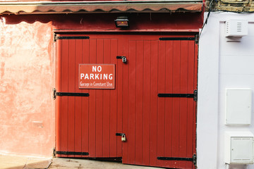 No Parking notice on a garage door.