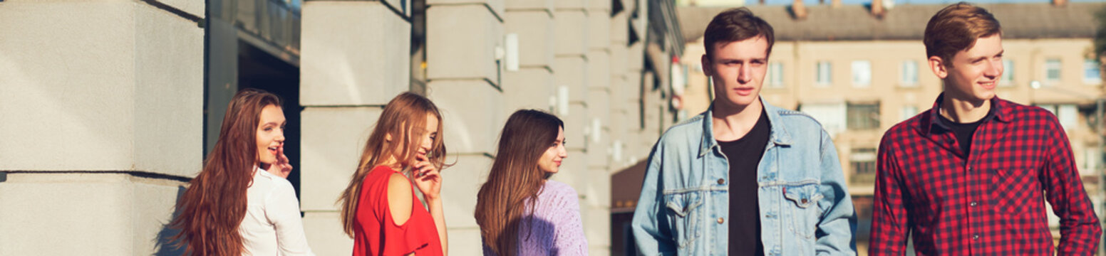 Group of young woman flirting with men in city. Friendship, leisure, student's lifestyle, first love, communication concept