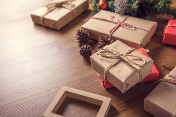 Closeup gift boxes for Christmas decorations on table wood background. copy space.
