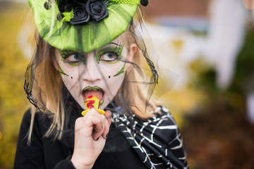 Little Girl Dressed Up In Witch Costume For Halloween With Elaborate Make Up