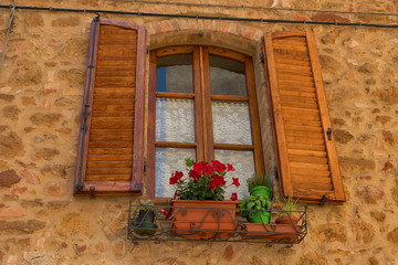 Traditional façade of Italian house in the small magical and old village of Pienza, Val D'Orcia Tuscany – Italy