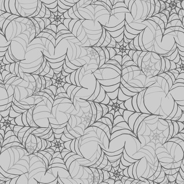 Hand drawn vector spider web seamless pattern on the gray background. Halloween design.