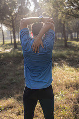 Young man stretching in a mountain forest