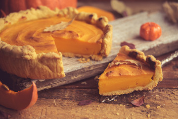 Homemade Pumpkin Pie with Autumn Decoration