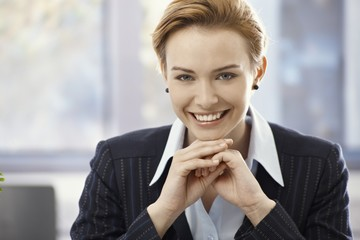 Closeup portrait of beautiful happy businesswoman