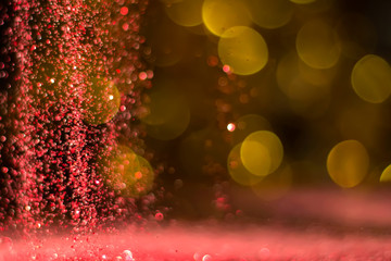 background golden bokeh with red glitter.