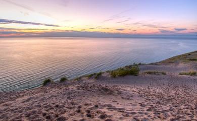 Sleeping Bear Dunes National Lakeshore. Massive sand dune at sunset on the shores of Lake Michigan in the Sleeping Bear Dunes National Lakeshore in Michigan.