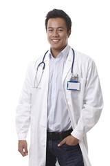 Happy doctor standing hand in pocket