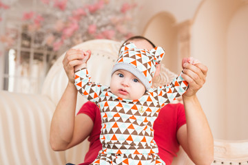 Adorable Caucasian baby and his father. Portrait of a three months old baby boy