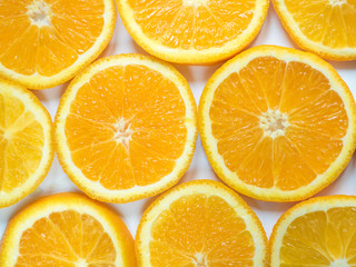 Abstract background with citrus-fruit of orange slices. Close-up.