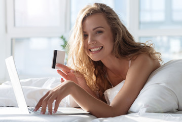 Hilarious smiling female person holding card