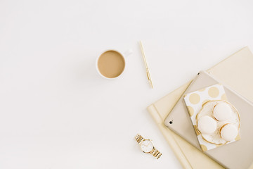 Flat lay modern concept with macaroons, coffee mug, feminine stuff on white background. Top view minimal lifestyle concept.