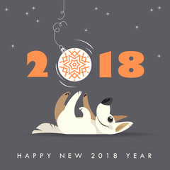 Cute dog plays with Christmas ball. Happy 2018 new year. Holidays greeting card.