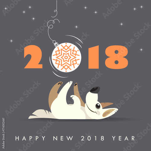 cute dog plays with christmas ball happy 2018 new year holidays greeting card