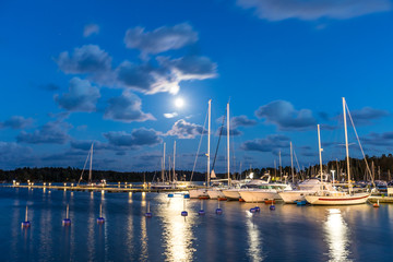 Sailing boats and yachts in marina at night. Nynashamn. Sweden.