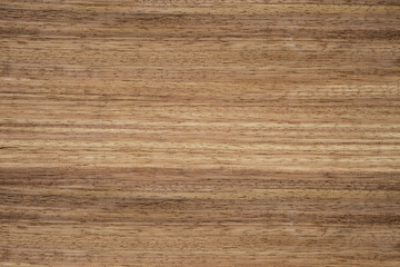Texture of wood with a natural pattern. Red tree. Veneer.