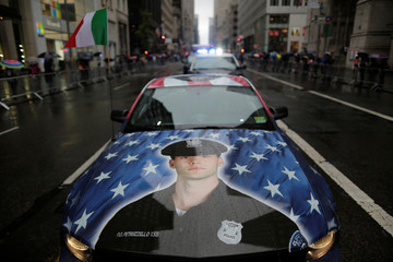 A car with a picture of a New Jersey police officer is seen during the 73rd Annual Columbus Day Parade in New York