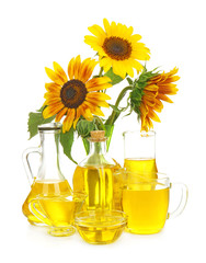 Composition with cooking oil and sunflowers on white background