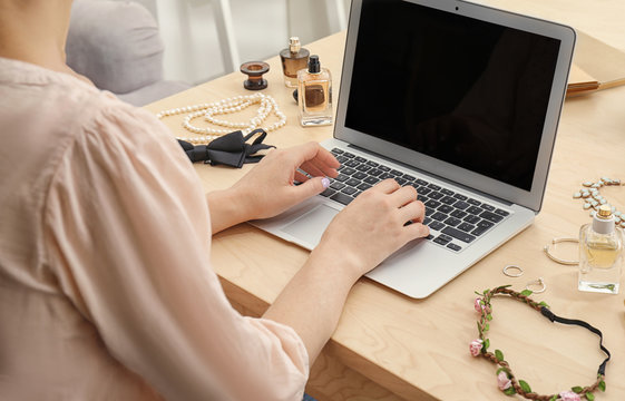 Woman working with laptop at table