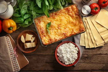 Composition with tasty spinach lasagna on wooden table