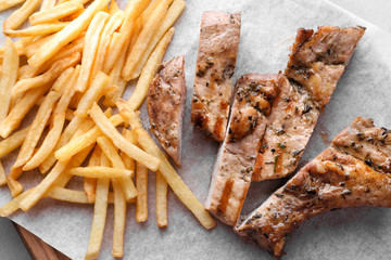 Delicious grilled steak frites on waxed paper
