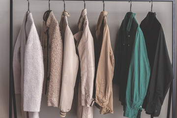 Various female outwear on hangers
