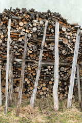 A pile of stacked firewood. Preparation for winter season. Ukraine