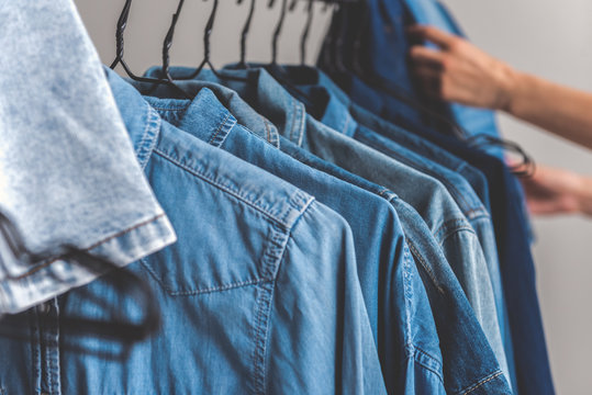 Person choosing article of denim clothes