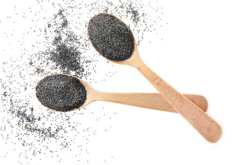 Spoons with poppy seeds on white background