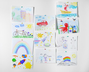Colorful children's drawings on white background