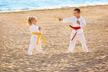 Little children practicing karate outdoors