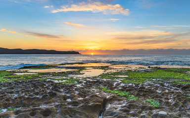 Sunrise Seascape and Mossy Green Rock Platform