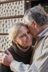 Senior couple embracing indoors