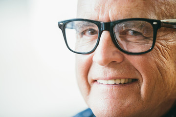 Senior stylish man smiling closeup portrait wearing glasses